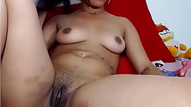 Mullato slut fingers hairy pussy and shows ass on cam