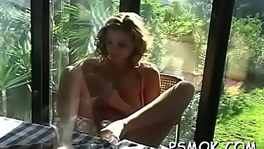 Jaw dropping playgirl teasing with a cigarette in her mouth