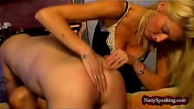 Lusty blonde domina spanks her slave