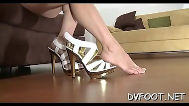 Beauty gives a steamy footjob and gets her sex toes sucked