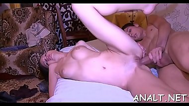 Demure hottie is groaning wildly as hunk pounds her anal canal