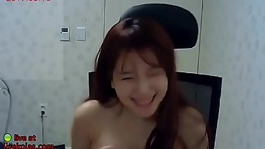 Asian redhead plays with her nice tits