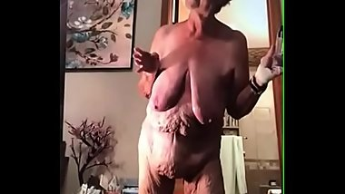 Old granny with a saggy belly, and tons of wrinkles using a egg.