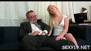 Sweet darling is delighting elderly teacher with oral sucking