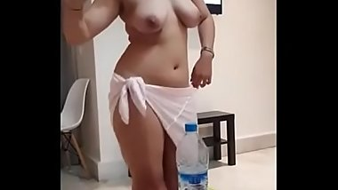 Busty Call girl doing nude dance