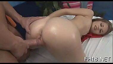 Watch this sexy and slutty 18 yea rold get screwed hard from behind by her massage therapist