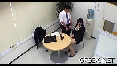 Hot young secretary provokes a horny lad in the office