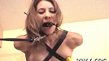 Attractive young beauty gets her first slavery experience