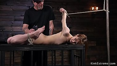 Hogtied redhead slave gets waxed