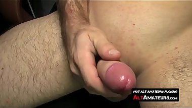 Handsome alt stud intensely jacking off uncut dick to porn