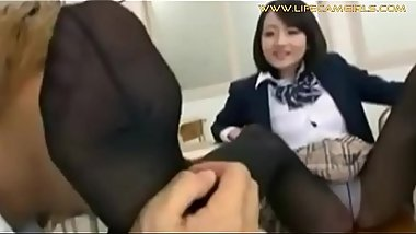 The teacher sniffs and licks the feet in her fragrant stockings with her Asian schoolgirl www.lifecamgirls.com
